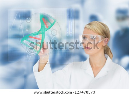Doctor using touchscreen displaying DNA helix diagram in operating theater