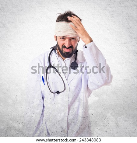 Doctor with headache over textured background