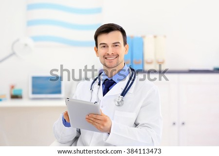 Doctor with tablet in office