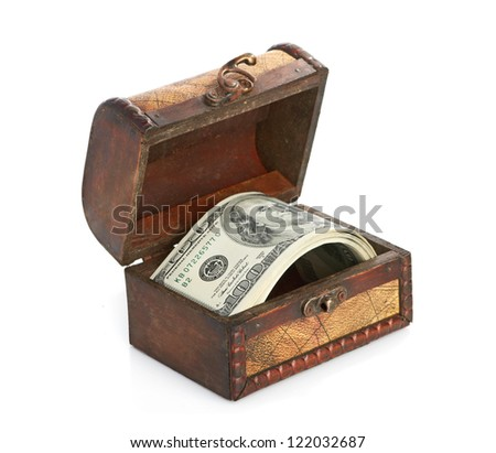 Dollar-bills in the old wooden treasure chest isolated on white background