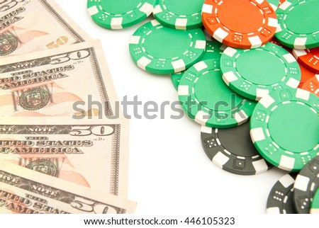 dollars and colored plastic chips on white