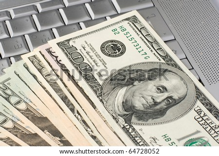 dollars on a laptop