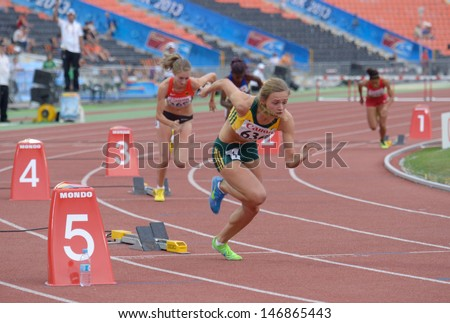 DONETSK, UKRAINE - JULY 13: Swanepoel of South Africa (in front) fight for her hold medal in the final of 400 m hurdles during 8th IAAF World Youth Championships in Donetsk, Ukraine on July 13, 2013