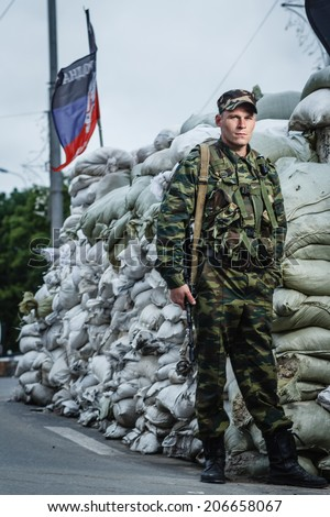 DONETSK, UKRAINE - JUNE 27: One of the fighters at the Russian Orthodox Army's block post on the road to the airport on june 27, 2014 in Donetsk.