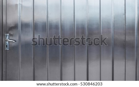 Door stainless steel metal surface background or aluminum silver brushed texture with reflection.