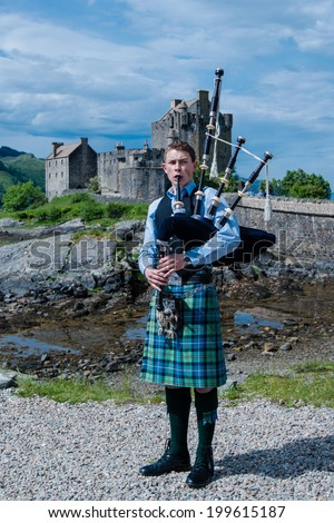 Dornie Scotland June 7 2014 A Bagpipe Player With