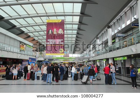 DORTMUND, GERMANY - JULY 17: People wait at the airport on July 17, 2012 in Dortmund, Germany. It exists since 1925 and had 1.7 million passengers in 2010.