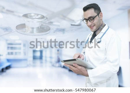 Double exposure of doctor use tablet.