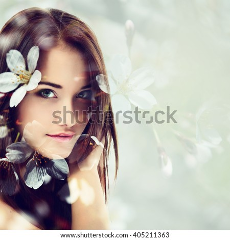 Double exposure of portrait of young beautifu girl and blooming cherry flowers. Youth and freshness concept.