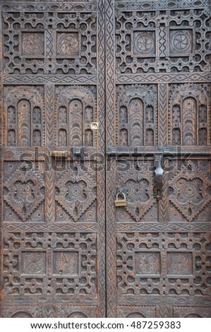 DRAA VALLEY, MOROCCO - MARCH 23, 2012: Detail of a decorated door in the kasbah of Ait Ben Haddou , in the south of the Draa Valley