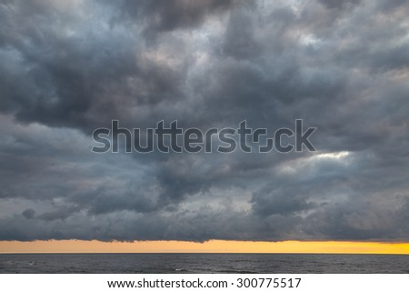 Dramatic sky with stormy clouds over the sea. Nature background