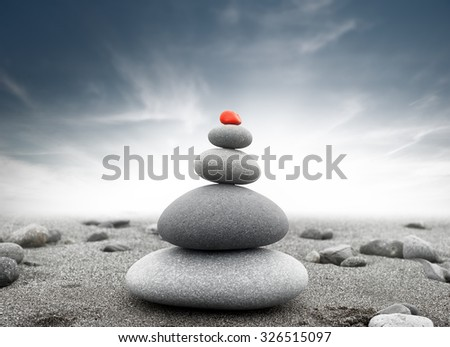 Dramatic spiritual background of zen-like stone pyramid. Tranquil and calm concept
