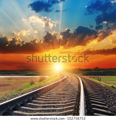 dramatic sunset over railroad