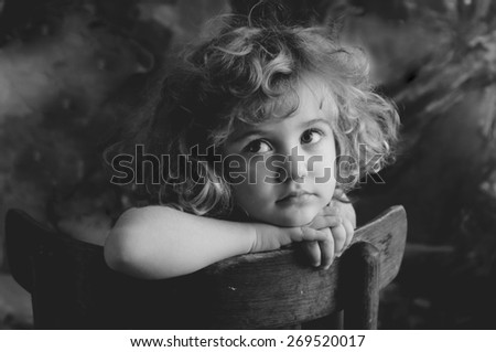 Dreaming beautiful little girl, monochrome portrait