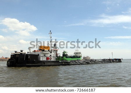 Dredger, industrial ship that digs sand
