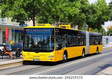 DRESDEN, GERMANY - JULY 20, 2014: Yellow articulated bus MAN A23 Lion's City GL at the city street.