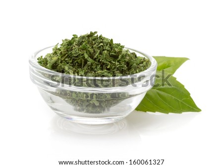 dried green spices in bowl isolated on white background