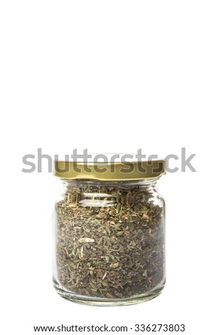 Dried lemon balm leaves in a mason jar over white background