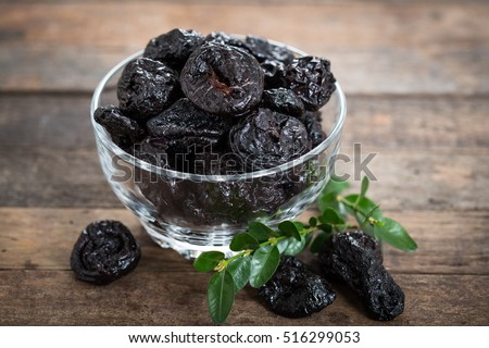 Dried plums - prunes in the bowl