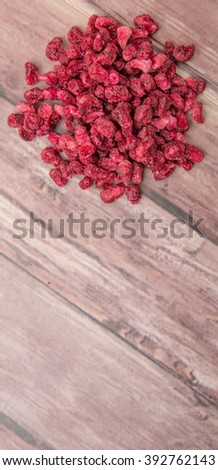 Dried pomegranate seeds over wooden background