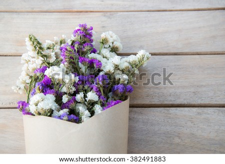 dried statice flowers on wood ,nostalgic still life ,