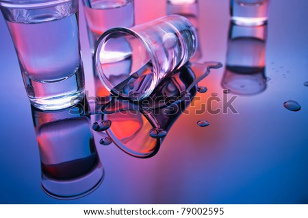 drink shot glasses with reflection in mixed light