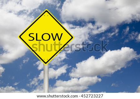 drive slow sign in yellow with copyspace
