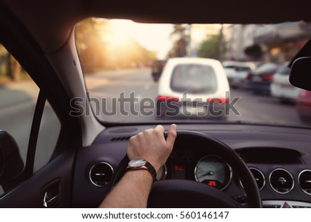 Driving a car through the city streets on a sunny day