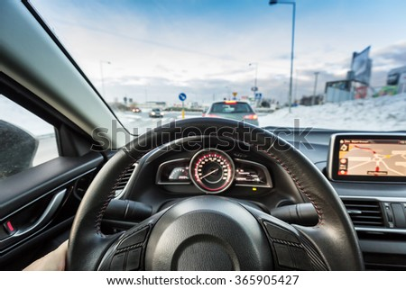 Driving a sport car. View from the driver position.