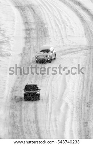 Driving on snow and snowy roads in winter traffic lights blizzard