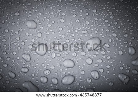 Drops of water on a color background. Toned.