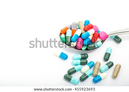 Drugs pill on spoon for your treatment your health with white background.