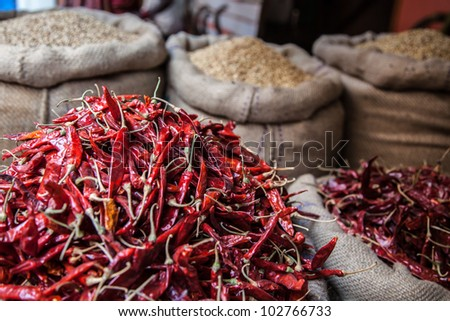 dry red chili pepper in sack at farmer market
