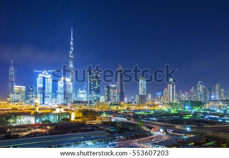 DUBAI FINANCIAL CENTER,UNITED ARAB EMIRATES-FEBRUARY 28, 2016: View on skyline of Dubai Financial Center with modern skyscrapers in Dubai city and construction site,United Arab Emirates