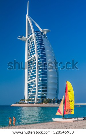 DUBAI,UAE-JAN 22: View of the luxury beach of Dubai and Burj al arab on the 22th of january 2010, in Dubai,Uae.The Bur is the most exclusive hotel of the world, and seven star 2010 in  Dubai