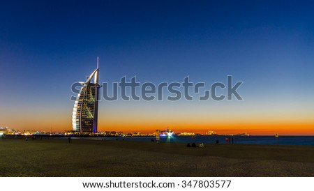 DUBAI, UAE - MARCH 1: High rise buildings, Burj Al Arab the luxury seven star hotel at sunset.