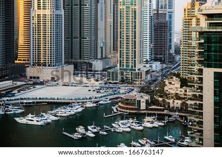 DUBAI, UAE - NOVEMBER 2: Dubai Marina at Dusk from the top, on November 2, 2013, Dubai, UAE. In the city of artificial channel length of 3 kilometers along the Persian Gulf.