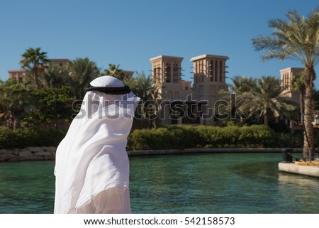 DUBAI, UAE - NOVEMBER 7, 2013: Man in Arab dress in Madinat Jumeirah hotel