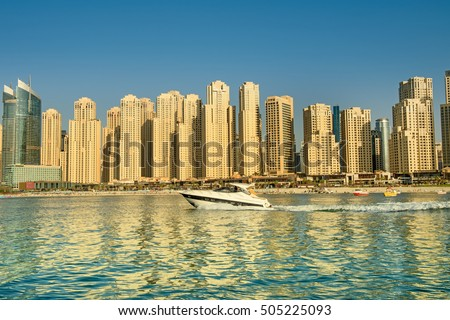 DUBAI, UAE - OCTOBER 09, 2016. View of various skyscrapers in Jumeirah Beach Residence (JBR) with stunning turquoise waters as foreground