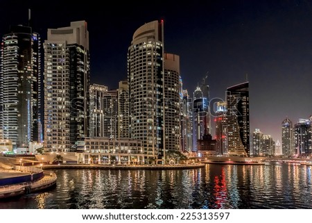 DUBAI, UAE - SEPTEMBER 29, 2012: Night view at modern skyscrapers in Dubai Marina. United Arab Emirates. Dubai Marina - artificial canal city, carved along a 3 km stretch of Persian Gulf shoreline.