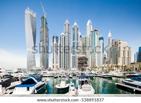 DUBAI, UNITED ARAB EMIRATES, APRIL 28, 2016: Dubai marina bay with yachts on a sunny day
