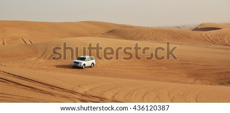 DUBAI, UNITED ARAB EMIRATES - APRIL 20, 2016: Safari Toyota rally off-road car 4x4 adventure driving Toyota in the desert sand dune is a popular activity among tourists in Dubai.