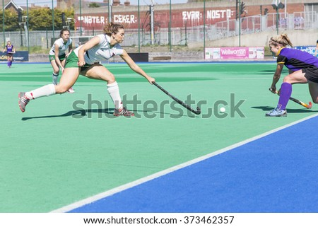 DUBLIN, IRELAND - APRIL 18, 2015: Unidentified athletes playing in the Women Irish Junior Cup 2015 semi final held between Pembroke Wanderers and Queens University. Pembroke won by 2 goals to nil.