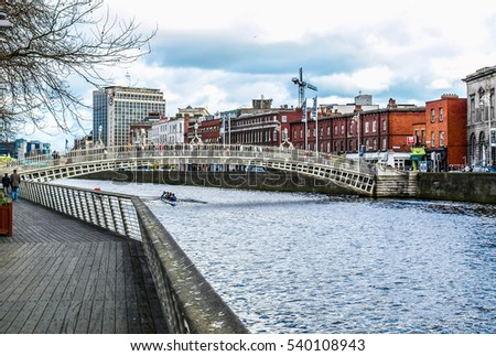 DUBLIN, IRELAND - MARCH 01, 2009: The Liffey Bridge is commonly known as Ha penny Bridge meaning Half Penny Bridge since pedestrians had to pay a toll to cross it since its construction in 1816 (HDR)