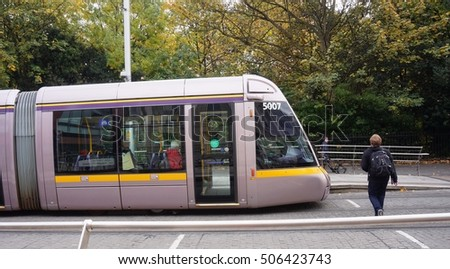 DUBLIN, IRELAND -29 OCT 2016- A LUAS tram stops at a station on the street in the Irish capital.