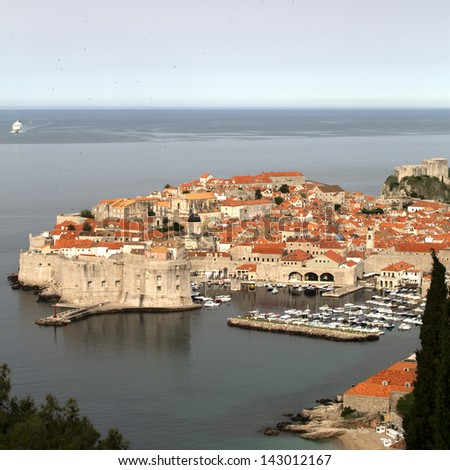 Dubrovnik at dawn with cruise ship approaching