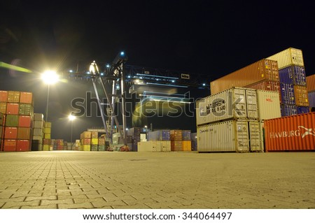 DUISBURG, GERMANY - 03 August 2014 Containers, Portal-cranes, trains and other vehicles of transportation in Logistics Center - Logport Duisburg at night