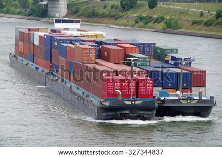 DUISBURG, GERMANY - 11 August 2012 Riverboat with containers on the river Rhine