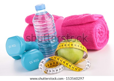 dumbbell with green apple and water