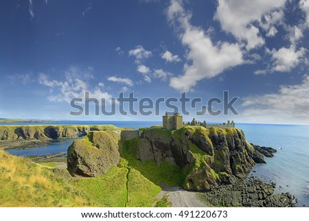Dunnottar Castle with blue sky in Stonehaven, Aberdeen, Scotland, United Kingdom